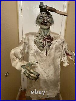 Spirit Halloween Axe'd Zombie Life Size 6 ft. Figure Prop Same Day Ship Retired