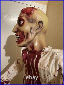 Spirit Halloween Bloody Zombie Life Size Prop Limb Eater Retired