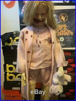 Spirit Halloween Walking Dead Girl Teddy Bear Animated Prop Zombie Animatronic